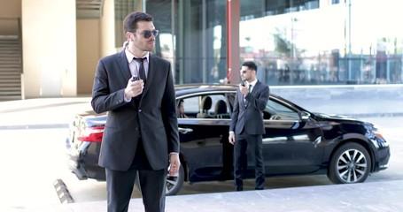 Bodyguards escorting a businessman © AntonioDiaz