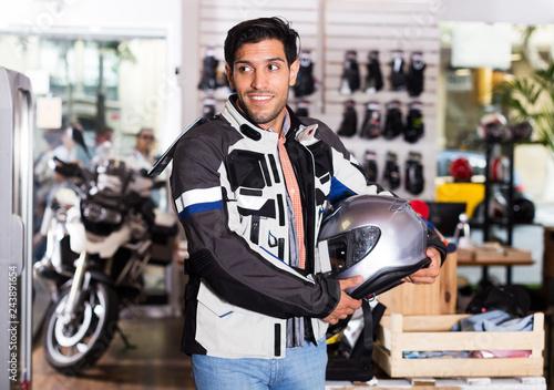 Man in moto equipment store
