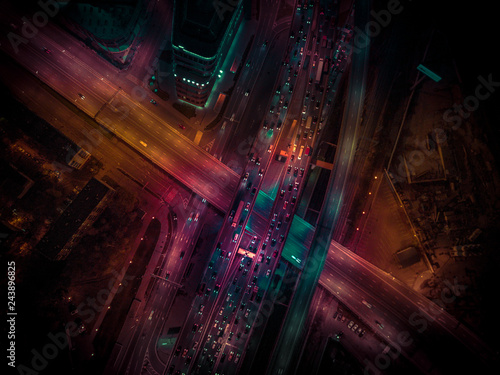 Night traffic on a city roads. Aerial view - 243896825