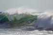 Green breaking wave