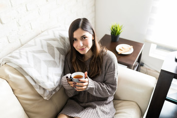 Woman Drinking Tea At Home © AntonioDiaz