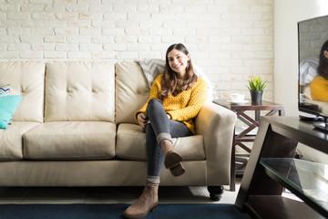 Pretty Woman Sitting Comfortably On Sofa © AntonioDiaz
