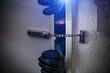 Leinwandbild Motiv burglar with torch opens door of appartment
