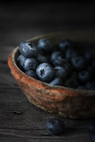 Blueberry on white wooden table Blueberries in wooden vintage bowl, Close up of blue berry