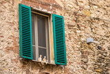 Backgrounds wtih brick walls, green and wooden shutters, ancient doors. Life in the streets of Umbria, Italy-vintage chame - 243946026