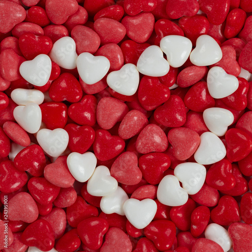 Close up of red, pink and white heart shaped candy - 243959001