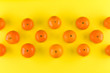 Fruit pattern of mandarin isolated on yellow background. Tangerine. Flat lay, top view. - 243961095