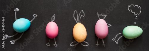 Leinwandbild Motiv Easter  funny painting  eggs on blackboard abstract children's background