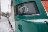 modern high-speed train in a snowstorm in winter