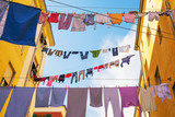 Drying of clothes in in italian city. - 244017422