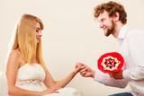 Man giving woman candy bunch flowers. Happy couple - 244017649