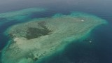 seascape aerial view coral reef, atoll with turquoise water in sea.Tropical atoll, coral reef in ocean waters. Travel concept. Aerial footage. - 244032802