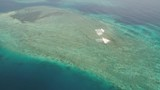 seascape aerial view coral reef, atoll with turquoise water in sea.Tropical atoll, coral reef in ocean waters. Travel concept. Aerial footage. - 244035292