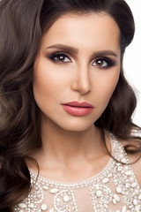 Woman in beige shine dress with wavy hairstyle, perfect skin after beauty salon.  Professionally make up, long eyelashes and stylish look. © Вячеслав Косько