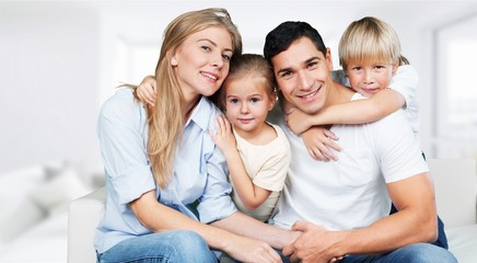 Beautiful smiling Lovely family watching  tv on background