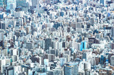 Zoom detail close up of Tokyo city skyline from above at blue hour - Japanese world famous capital with spectacular urban landscape panorama - Concrete cement jungle concept on azure filter