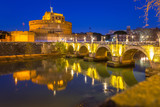 Saint Angel Castle over the Tiber river in Rome at night, Italy