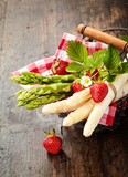 Fresh bunches of green and white asparagus tips - 244067271