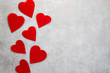 Red decorative hearts on a gray background. Valentine's Day Concept.