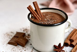 Homemade hot chocolate in a white enamel mug. - 244114203