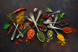 Assortment of natural spices on a vintage spoons.Top view with copy space. - 244114481