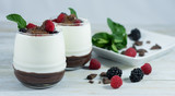 Dessert of yogurt with chocolate, red berries and mint.