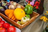 Autumn harvest: vegetables in a basket, zucchini, onions, eggplant, pepper, pumpkin - 244133806