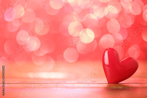 Single heart and red bokeh abstract background