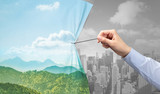 hand pulling nature cityscape curtain to gray cityscape, environmental protection concept - 244137669