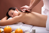Therapist Giving Back Massage To Young Woman