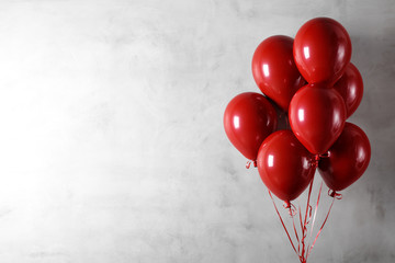 Balloons on concreat wall background © lily