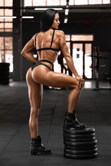 Fitness sexy woman working out in gym. Sexy beautiful butt in thong. Muscular girl, muscles back © nikolas_jkd