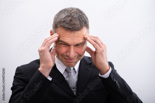 Poster Businessman Suffering From Headache