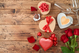 Valentine's day concept with coffee cup, heart shape chocolate, rose flowers and gift boxes