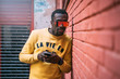 Cheerful african man with mobile phone and yellow sweater.