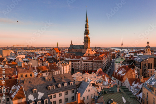 Aerial winter sunset over Riga old town and river Daugava in Latvia.
