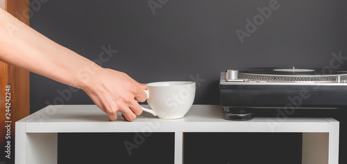 male hands use turntable. music lover b - 244242248