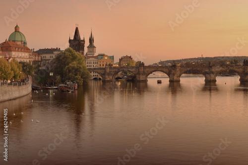 Charles Bridge and Vltava river view in Prague during sunset
