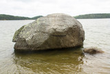 Glacial erratic on shore of Cliff Pond at Cape Cod.