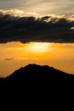 Fototapeta Na ścianę - Mountain and sky at sunset © somesense