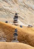 Vertical Balancing Pebbles on a Rock - 244291419