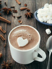 Hot chocolate with marsmallow in heart shape. St. Valentine Day concept. Copy space.