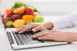 dietitian typing treatment to patient via internet