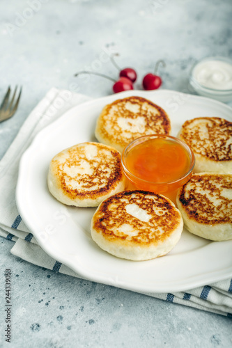 Cheesecakes, cottage cheese pancakes, delicious breakfast, apricot jam