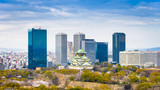 Fototapeta Miasto - Osaka, Japan at skyline and castle in springtime from above. © SeanPavonePhoto