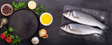 fresh fish with  ingredients for cooking, top view - 244352474