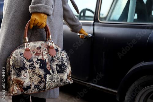 Fridge magnet woman opening the door of an old car