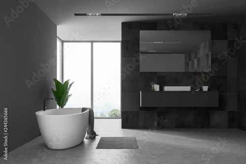 Black tile bathroom, window and tub