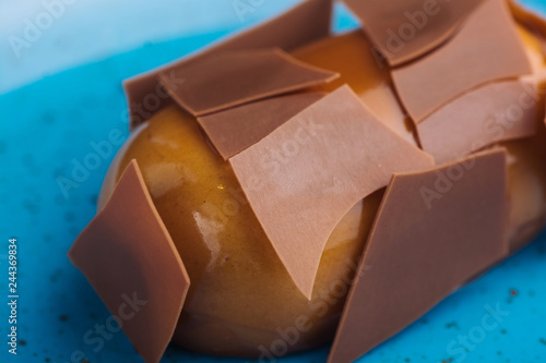 Chocolate cake on blue plate with caramel