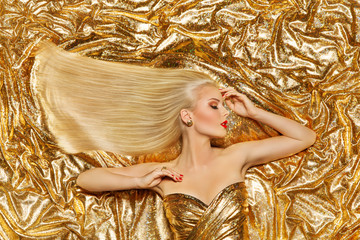 Gold Hair, Fashion Model Golden Straight Hairstyle, Blonde Girl on Shiny Sparkles Background © inarik